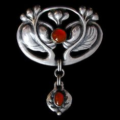 This is not contemporary - image from a gallery of vintage and/or antique objects. BERNARD HERTZ  A silver brooch, set carnelian with carnelian drop.