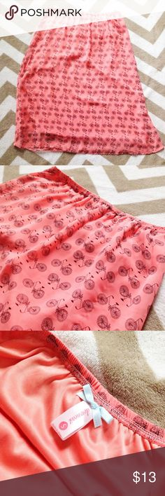 """🚲Bicycle Print Salmon Pink Knee Length Skirt Oh-so cute bicycle printed knee length skirt in a lovely Salmon pink! // skirt length is 24"""" // fully lined // hits at knee on me - I'm 5'3"""" // lightweight silky polyester Downeast Skirts A-Line or Full"""