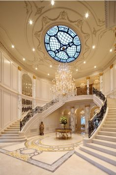 Horseshoe Staircase with chandelier