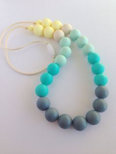 This nursing necklace is made from 100% non-toxic food grade chew safe silicone beads. I string and knot the beads with durable 2mm silk