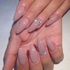 Rhinestone accents add shimmer and texture to your pink acrylic nails