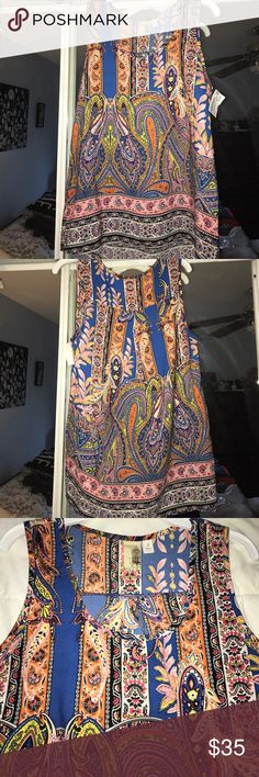 Anthropologie paisley floral drapery tank top S Anthropologie gorgeous flowy drapery tank top. Light and airy, perfect for SUMMER! Colorful formal & paisley pattern. Flawless. Size Small. Anthropologie Tops Tank Tops