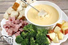 This creamy Swiss & Cheddar Cheese fondue couldn't be any simpler to make, yet it is perfect for holiday dinners and parties with family and friends!