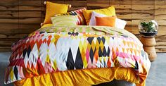 Kip and Co Bedding and Cushions - the Gold Spots is super cool and the Croc Confetti Toucan duvet is amazing!