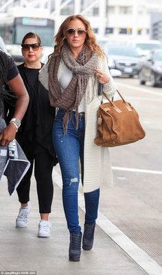 Flying with style: Actress Leah Remini leaves LAX with a full-on fashion statement...