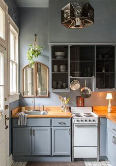 Shale makes a big visual impact in the small kitchen [Design: Logan Killen Interiors]