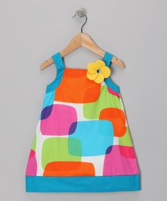 Colorful shapes collide on this playful, flower-adorned dress. Durably made from comfy cotton, this fanciful piece is ready to rule the playground on a daily basis.100% cottonMachine wash; tumble dryImported