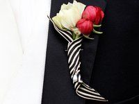 white & pink flowers and black & white ribbon for the boutonniere.