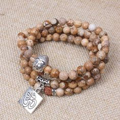 Rudraksha beads are believed to provide a kind of protective energy for the wearer, to shield them from various circumsta Buddha Head, Stone Bracelet, Natural Stones, Feminine, Beaded Bracelets, Boutique, Boho, This Or That Questions, Beads