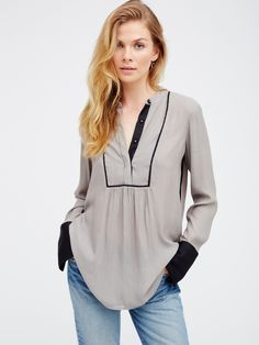 Free Bird Striped Pullover | Striped pullover blouse with contrast details. Snap buttons along the placket and sleeve cuffs. Light and silky fabrication. Rounded hem.