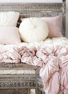 Lovely pink bedding on a gorgeous silver/gray bed. <3
