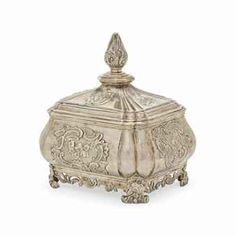 A DUTCH SILVER TEA CADDY, MARK OF RUDOLF SONDAG, ROTTERDAM, 1763 Bellied oblong form with domed, hinged cover and large foliate knop finial, fluted corners and sides chased with rococo floral cartouches, on rocaille feet, with applied openwork rococo bands between the feet.