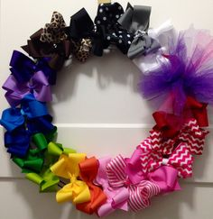 Rainbow wreath for baby showers, Christmas gifts, and more. Visit Facebook.com/bnavillebowtique to get your own!