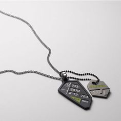 DIESEL Shapes and Color Necklace $105.00   $52.50 Style #: DX0449    A lost security badge? A cut up license? Whatever these two pendants are, they're certainly not anything less than interesting.