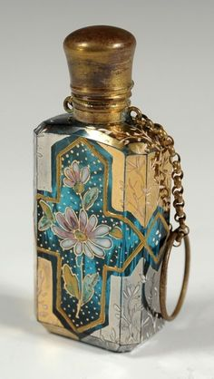ENAMELED GLASS PERFUME BOTTLE WITH FINGER LOOP : Lot 426