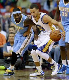 Description of . Golden State Warriors guard Stephen Curry, right, grabs a loose ball in front of Denver Nuggets guard Ty Lawson during the first half of a preseason NBA basketball game, Thursday, Oct. 16, 2014, in Des Moines, Iowa. (AP Photo/Charlie Neibergall)