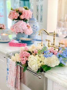 Southern Charm Inspired Spring Home Tour #spring #flowers #sinkshot #sink #farmhousesink #kitchen #beautifulkitchen #sinkofflowers #traderjoesflowers #pinkrose #hydrangea #delphinium #whitehydrangea #whiteroses #sprayroses #weddingflowers