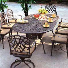 meubles de jardin en fer forgé pour le patio avec sol en béton