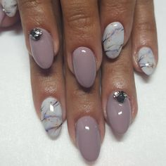 Taupeless beach by OPI with marble accent nails.