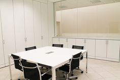 Meeting Room with Partitions - Equipped Wall Partitions High and Low Cabinets Model ONE - Glass Partitions Model CRYSTAL with Aluminium Frame - Table Model FUJI ALLUMINIO  White and Aluminium - Chairs Model VISUAL NET with Black Mesh and Aluminium Structure