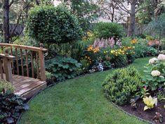 Beautiful backyard with grassy pathways around smaller garden beds
