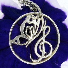 Butterfly Treble Clef quarter cut coin necklace by NameCoins, $69.99