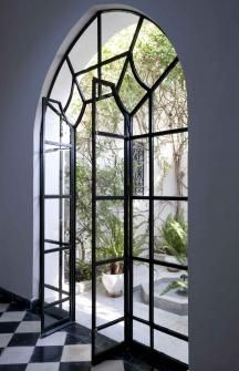 I love this door in the window, perhaps a different window pane design but I love the over all idea