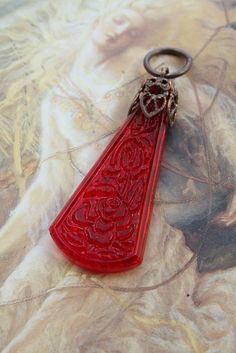 Vintage RARE Carved Floral Red Glass UPCYCLED Filigree Pendant by uppsydaisy on Etsy https://www.etsy.com/listing/88300665/vintage-rare-carved-floral-red-glass
