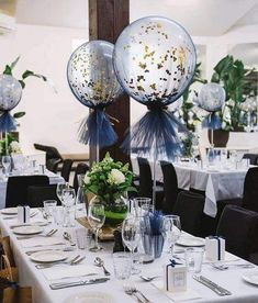 Blue and gold balloon centerpiece using 5 balloons cub scouts wedding balloon decorations balls decorated with golden confetti and a blue cloth adorn the wedding reception boutique balloons melbourne junglespirit Image collections