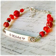 Vegan Veganism Bracelet  Hand stamped metal with the word Vegan in it.  Toho beads, czech glass beads.  Bracelet size is 17.5 cm plus a 4cm