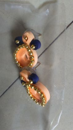 Quilled peach color stud with blue combo