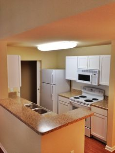 Kitchen in an Updated 1/1. Can't you see yourself making some tasty meals in here?! #azaleaplace