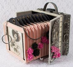 I used Mister Tom's Treasures and Pion Design Palette to make this new design. The front doors of the case open to reveal a pop-out accordion vintage camera that holds photos or tags. The camera can