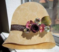 love the vintage hat...made with sizzix die rolled flower, Martha Stewart flower punch, Bo Bunny paper, hand cut hat design...tutorial for how she made the beautiful leaf...great job..