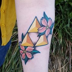 Ahmaaazing tattoo I got at Black Cobra Tattoos in Sherwood, AR. #legendofzelda #triforce #triforcetattoo #zeldatattoo #legendofzeldatattoo #cherryblossom  #cherryblossomtattoo #geekytattoos