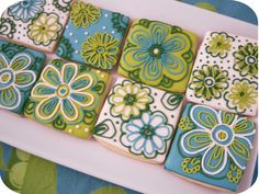 Iced Biscuits in Kyoto Japan. I would love to recreate in embroidery... The colours! The flowers! The spiral repeat patterns, the overlap. Love love love... floral tile cookies