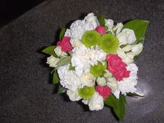 Bride's bouquet with roses, carnations, mini carns and kermit mums.