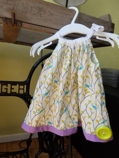 This cute baby girl summer dress is super cute and practical for the warmer months. This dress has a cute ribbon neck line which ties into a bow on one side, which allows you to adjust the dress to fit your bub super easy.