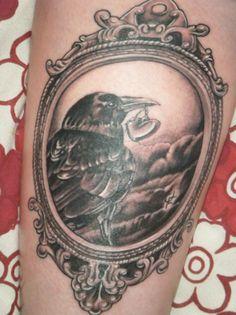 what a fabulous tattoo! raven.. frame.. gaaahh... LOVE!