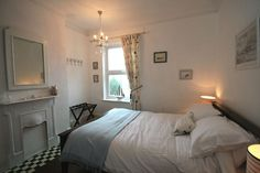 Bright Side, Hunstanton, Norfolk - typical seaside town house with all the charm of a Victorian property - bay windows and original features such as cast iron fire surrounds and stripped pine flooring and doors. From £380 pw. Sleeps 6.