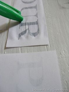 WHO KNEW!! you print out words on basic white paper, but in mirror image form lay them on the wood with a damp paint brush wet the paper on top of the words use the cap of a sharpie to rub on top of the letters to help them transfer  then remove the p