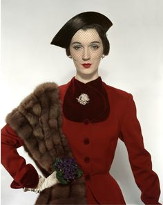 1950 Dovima in Pacific Craft Fabric woolen suit trimmed in velvet, hat by Lilly Daché