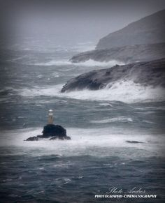 famous lighthouse of Chora Andros during severe weather