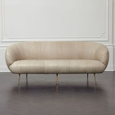 KELLY WEARSTLER   LEATHER SOUFFLE SETTEE. Ruched leather detail. Full-finish, vegetable dyed lambskin is hand-stitched on to the frame.