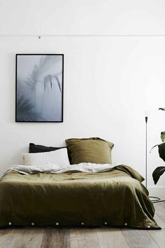 Idea: get plain, evergreen colored bedding...so it's easy to decorate around | Read 20 Examples Of Minimal Interior Design #15