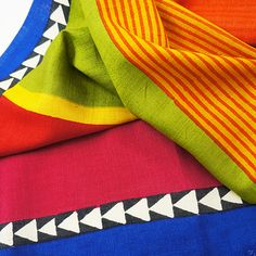 Sundance -- 100% Mulberry silk scarf with bright, exciting colors and patterns.