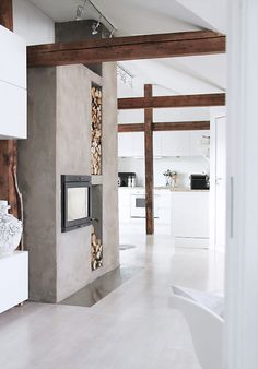 TheDesignerPad - The Designer Pad - NATURAL BEAUTY - white kitchen with exposed beams, concrete fireplace surround and recessed wood piles