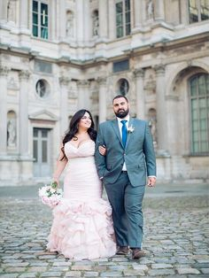 A curvy Parisian bride her in ruffled blush pink wedding dress.