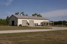 This large metal building and horse barns has special features like Hi-Rib Steel, Stone Wainscot, Porch, Cupola, Shutters, Energy Performer Insulation Package and Fibersteel Walk Doors. Scroll down and take...Read more