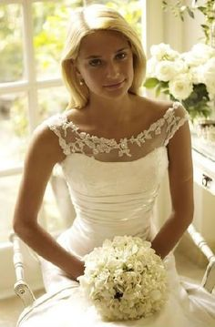 Beautiful Spring-like wedding dress. If you want the best officiant for your Outer Banks, NC, ceremony, contact Rev. Barbara Mulford: myobxofficiant.com/